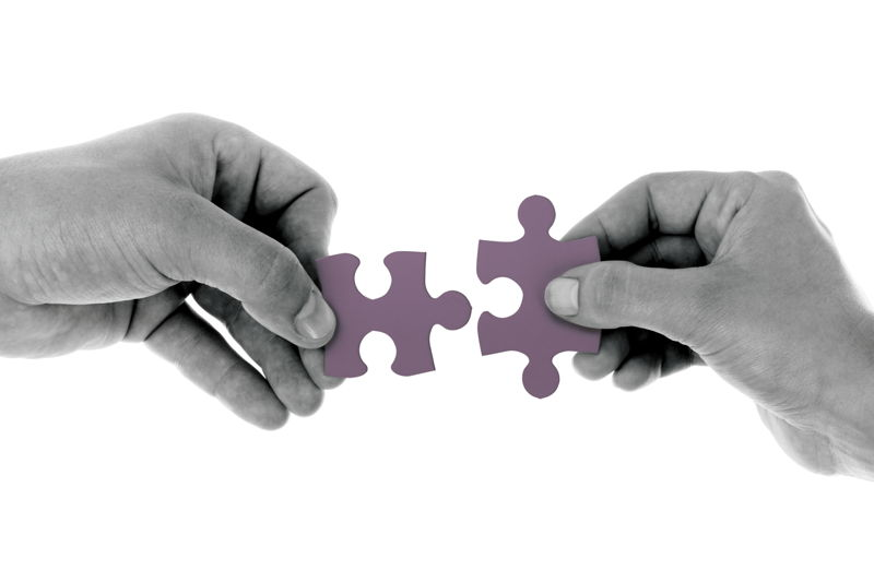 puzzle pieces hands holding